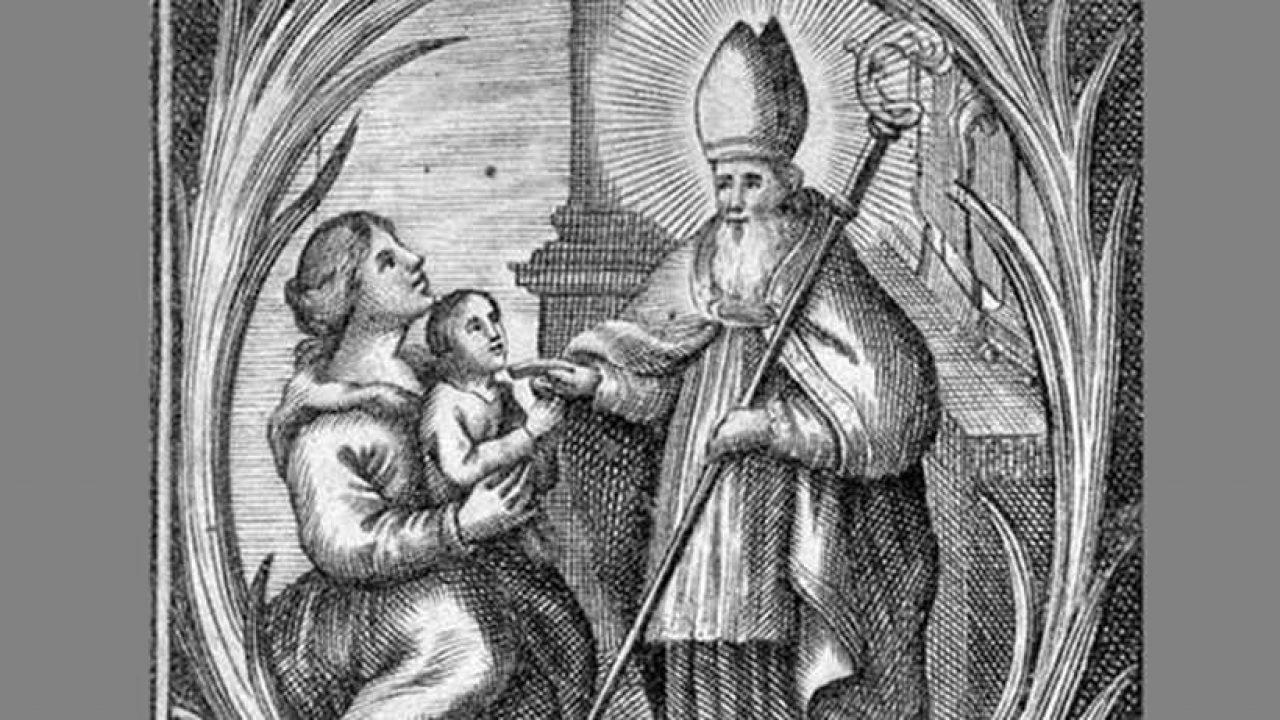 Püspök gyertyákkal és malacfejjel